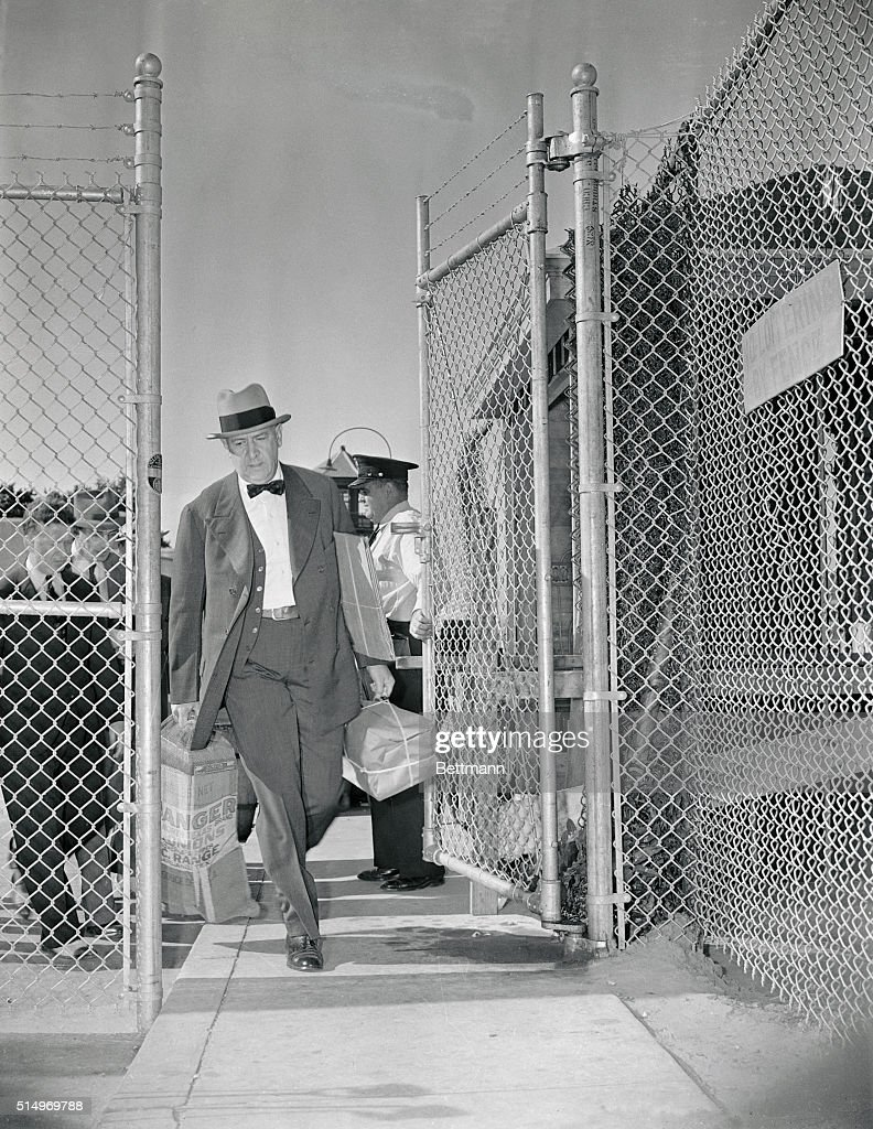 Richard Whitney the former President of the New York Stock Exchange, is shown leaving Sing Sing prison, after he had been paroled on serving 40 months of the sentence imposed for Grand Larceny in the theft of $214,000 of his client's funds. From the gates of the grim prison, Whitney headed straight by auto for Barnstable, Massachusetts, where a job as Manager of a Dairy Farm awaits him. He will run the farm, owned by former Lt. Gov. Caspar G. Bacon of Massachusetts for $200. a month and board. Terms of his parole bar him from Wall Street.