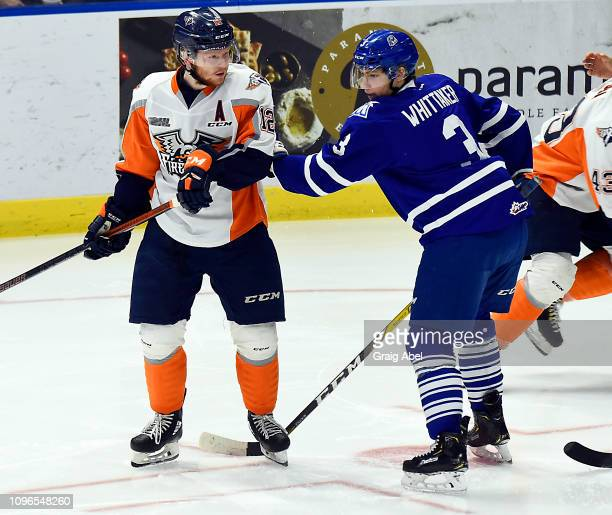 Richard Whittaker of the Mississauga Steelheads battles with Jake Durham of the Flint Firebirds during OHL game action on January 18 2019 at...