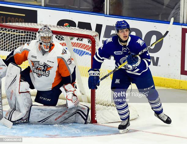 Richard Whittaker of the Mississauga Steelheads skates in front of goalie Emanuel Vella of the Flint Firebirds during game action on January 18 2019...