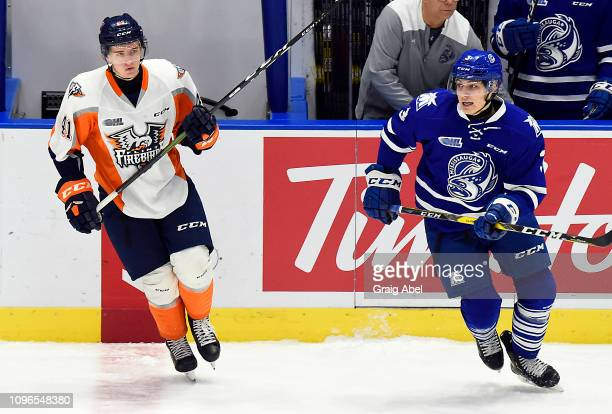 Richard Whittaker of the Mississauga Steelheads skates up ice against Evan Vierling of the Flint Firebirds during OHL game action on January 18 2019...