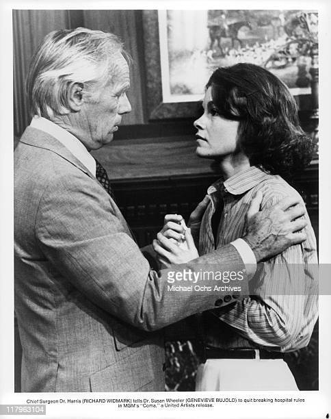Richard Widmark tells Genevieve Bujold to quit breaking hospital rules in a scene from the film 'Coma' 1977