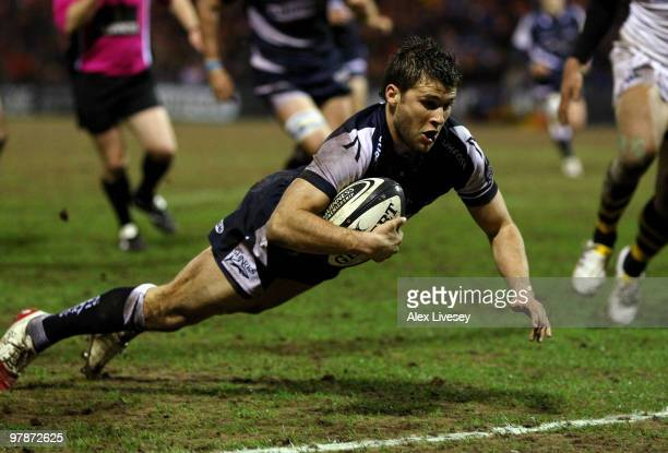 Richard Wigglesworth of Sale Sharks dives over the line to score his try during the Guinness Premiership match between Sale Sharks and London Wasps...