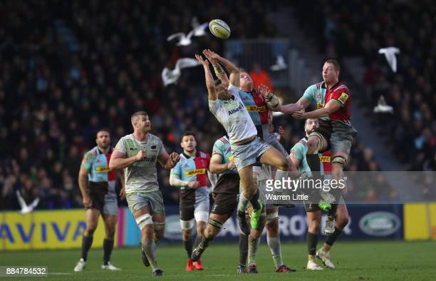 Richard Wigglesworth of Saracens and Renaldo Bothma of Harlequins jump fpr the ball during the Aviva Premiership match between Harlequins and...