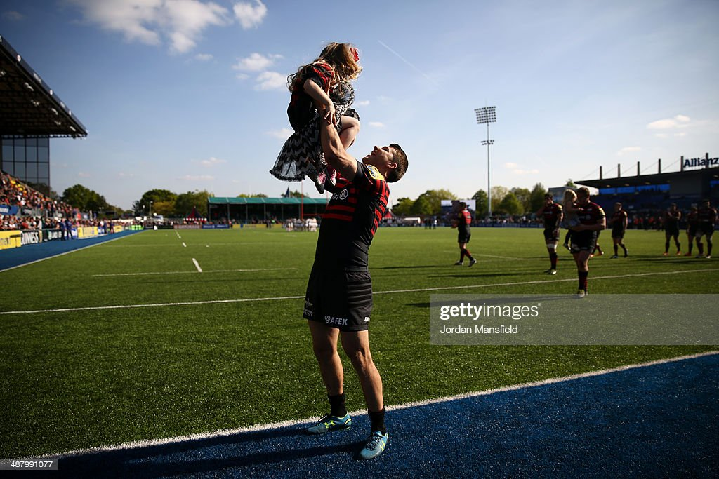 Richard Wigglesworth of Saracens celebrates with his daughter after the Aviva Premiership between Saracens and Worcester Warriors at Allianz Park on May 3, 2014 in Barnet, England.