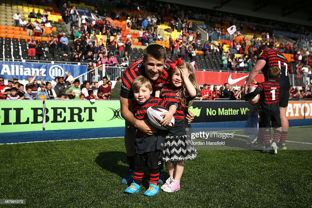 Richard Wigglesworth of Saracens poses for a photo with his son and daughter after the Aviva Premiership between Saracens and Worcester Warriors at Allianz Park on May 3, 2014 in Barnet, England.