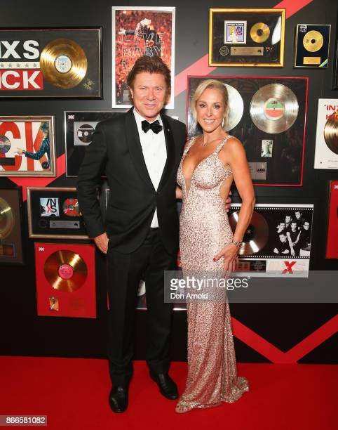 Richard Wilkins and Virginia Burmeister arrive ahead of the INXS Masquerade Party at State Theatre on October 26 2017 in Sydney Australia
