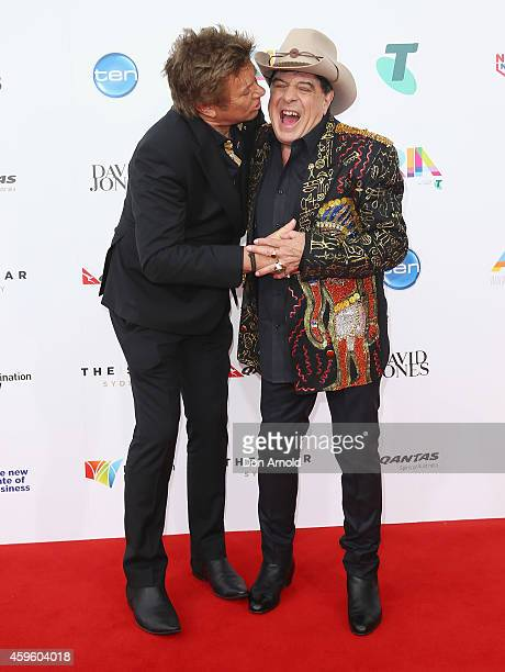 Richard Wilkins greets Molly Meldrum at the 28th Annual ARIA Awards 2014 at the Star on November 26 2014 in Sydney Australia