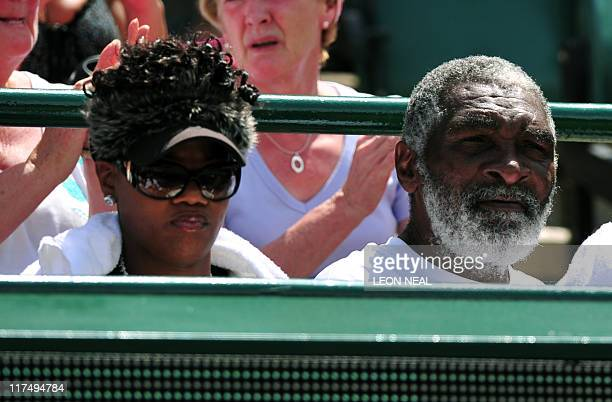 Richard Williams father and coach of US player Venus Williams and a friend react as French player Marion Bartoli plays with US players Serena...