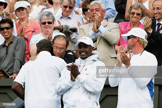 Richard Williams father and coach of Venus Williams of USA hugs Walter Bartoli father of Marion following the Women's Singles final match between...
