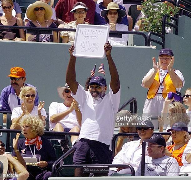 """Richard Williams, father of Venus and Serena Williams of the US, holds up a sign reading """"Welcome to the Williams Show"""" prior to the start of the..."""
