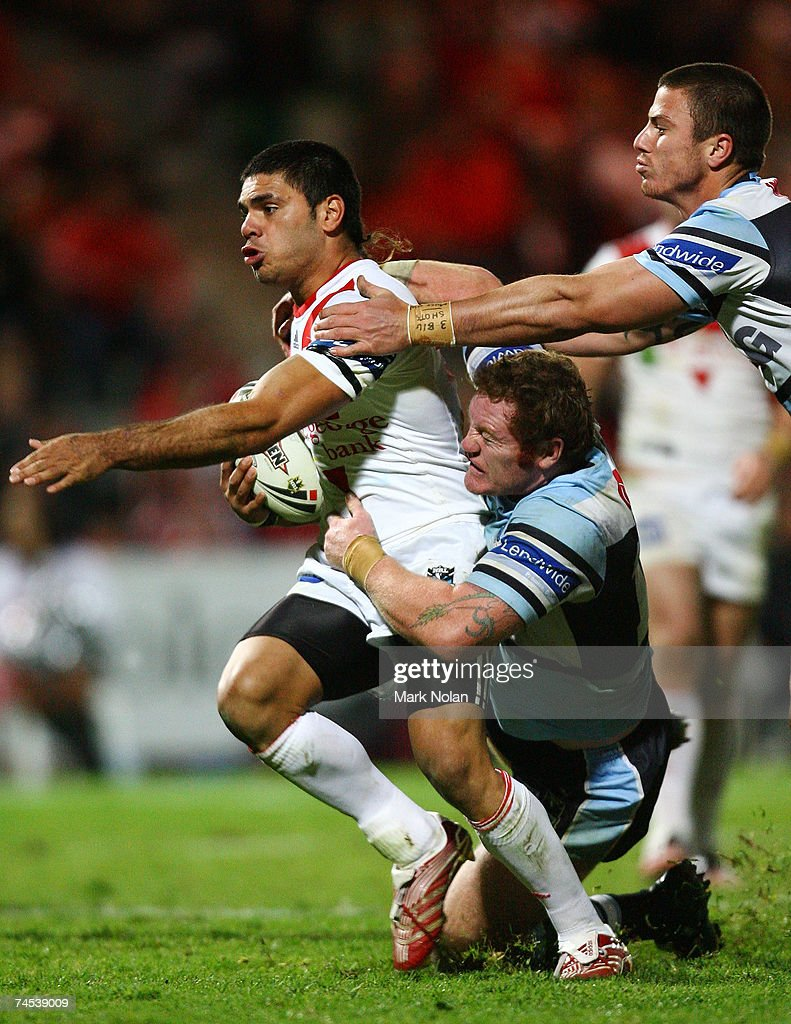 Richard Williams of the Dragons is tackled during the round 13 NRL match between the St George Illawarra Dragons and the Cronulla Sharks at OKI Jubilee Stadium June 11, 2007 in Sydney, Australia.