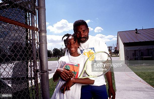 Richard Williams with his daughter Venus pose for a photograph 1991 in Compton CA Serena and Venus Williams will be playing against each other for...