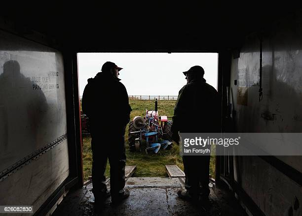 Richard Wilson from Bilsdale and Gordon Sumley from Scarborough stand talking in the back of a lorry during the annual ploughing match on November...