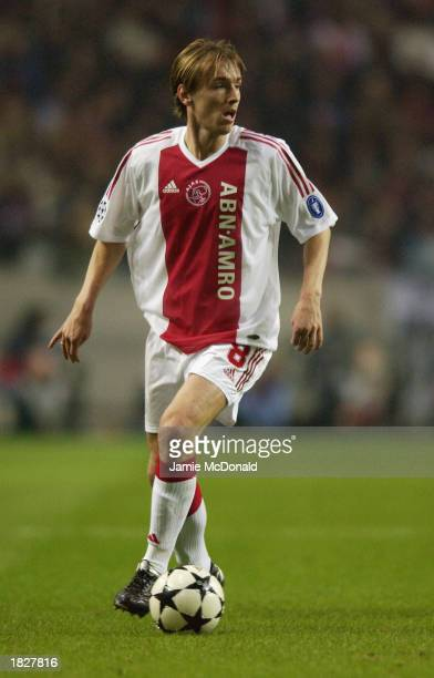 Richard Witschge of Ajax runs with the ball during the UEFA Champions League Second Phase Group B match between Ajax and Arsenal held on February 26...