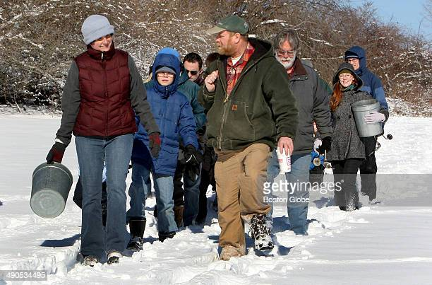 Richard Wolniewicz center leads maple sugaring group during the Tap a Tree event at the Massachusetts Audubon Society's Ipswich River Wildlife...