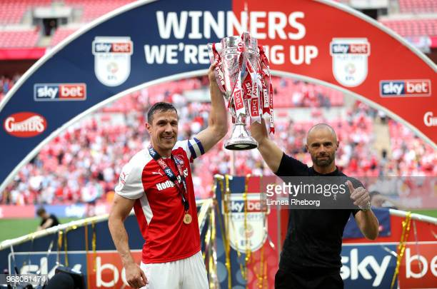 Richard Wood of Rotherham United and Paul Warne Manager of Rotherham United celebrate victory with the trophy after the Sky Bet League One Play Off...