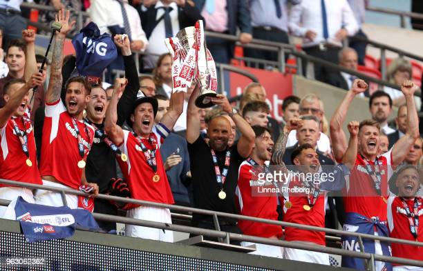 Richard Wood of Rotherham United and Paul Warne Manager of Rotherham United lift the trophy in victory after the Sky Bet League One Play Off Final...