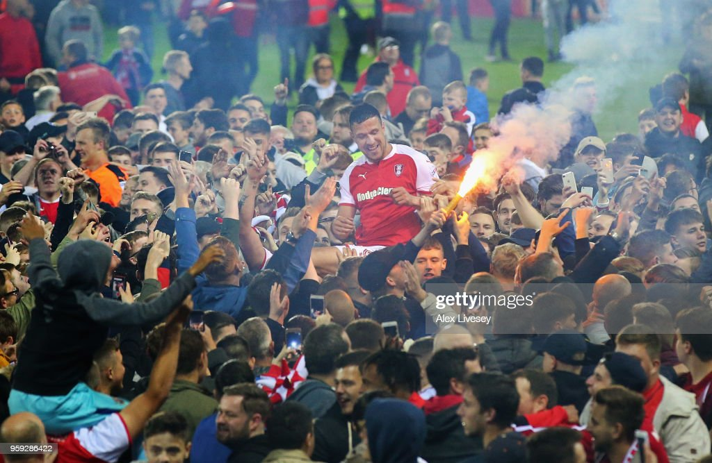 Richard Wood of Rotherham United is carried by supporters after victory in the Sky Bet League One Play Off Semi Final second leg match between Rotherham United and Scunthorpe United at The New York Stadium on May 16, 2018 in Rotherham, England.
