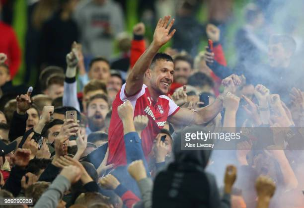 Richard Wood of Rotherham United is carried by supporters after victory in the Sky Bet League One Play Off Semi Final second leg match between...