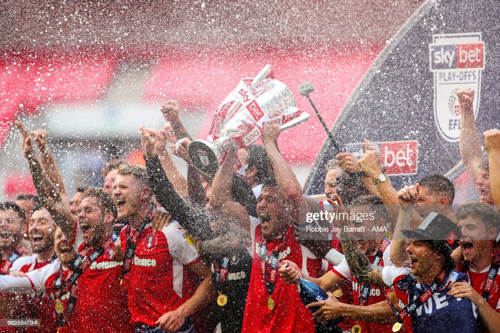 Richard Wood of Rotherham United lifts the EFL Sky Bet League One Play Off final trophy with his team mates during the Sky Bet League One Play Off Final between Rotherham United and Shrewsbury Town at Wembley Stadium on May 27, 2018 in London, England.