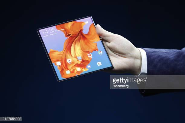 Richard Yu chief executive officer of Huawei Technologies Co presents the Mate X foldable 5G mobile device during a Huawei Technologies Co launch...