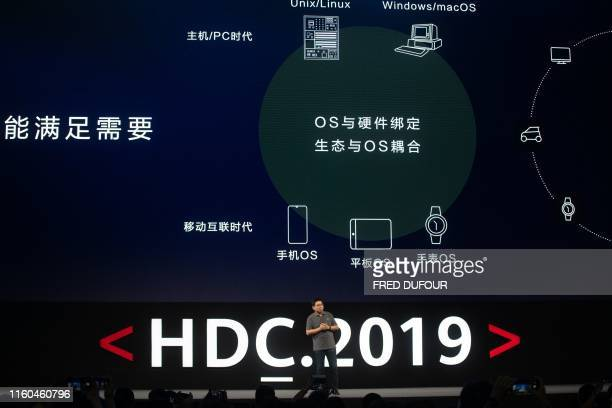 Richard Yu head of Huawei's consumer business unveils the company's new HarmonyOS operating system during a press conference in Dongguan Guangdong...