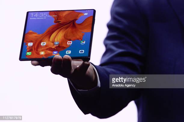 Richard Yu the CEO of Huawei's consumer products shows the new Huawei Mate X smartphone during the second day at the mobile World Congress 2019 in...