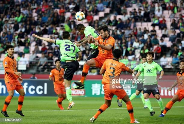 Richardo Lopes of Jeonbuk Hyundai Motors competes for the ball with Andres Jose of Buriram United during the AFC Champions League Group G match...