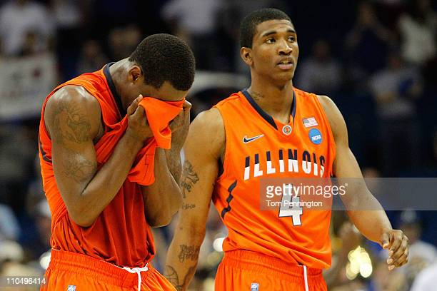 J Richardson and Crandall Head of the Illinois Fighting Illini react at the end of their 7359 loss to the Kansas Jayhawks during the third round of...