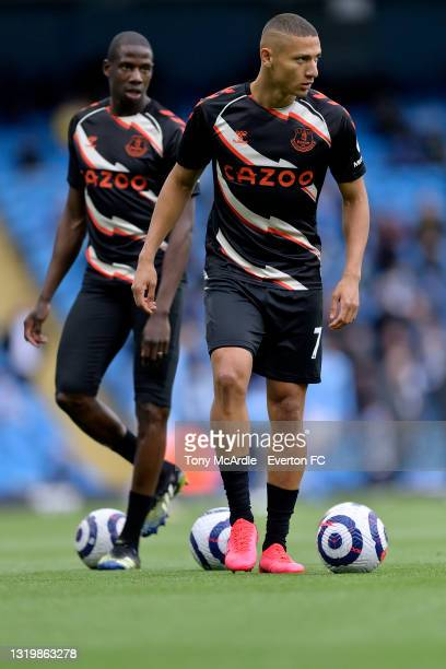 Richarlison and Abdoulaye Doucoure of Everton warms up before the Premier League match between Manchester City and Everton at the Etihad Stadium on...