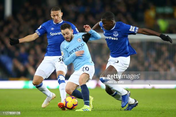 Richarlison and Kurt Zouma of Everton tackle Bernardo Silva of Manchester City during the Premier League match between Everton FC and Manchester City...