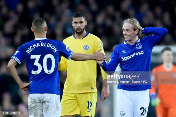 Richarlison and Tom Davies of Everton congratulate each other after the Premier League match between Everton and Chelsea at Goodison Park on March...