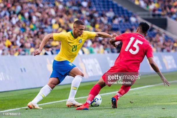 Richarlison Andrade of Brazil dribbles Eric Davis of Panama during the International Friendly Match between Brazil and Panama at Estadio do Dragao on...