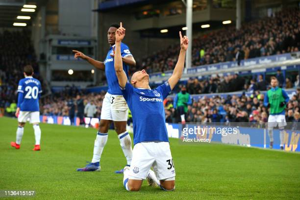 Richarlison celebrates after scoring his sides first goal during the Premier League match between Everton FC and Chelsea FC at Goodison Park on March...
