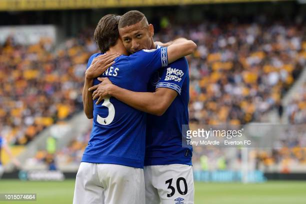 Richarlison celebrates his goal with Leighton Baines during the Premier League match between Wolverhampton Wanderers and Everton FC at Molineux on...