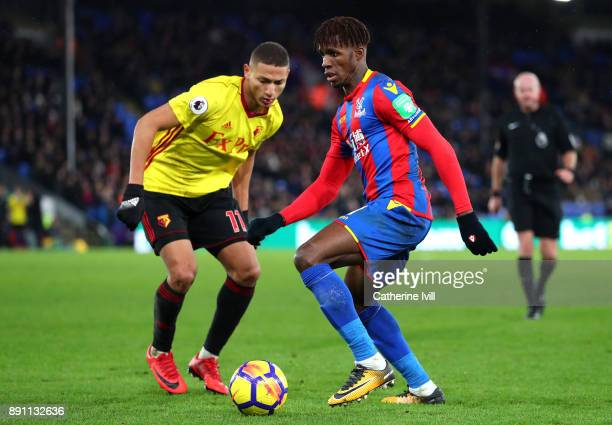 Richarlison de Andrade oaf Watford and Wilfried Zaha of Crystal Palace during the Premier League match between Crystal Palace and Watford at Selhurst...