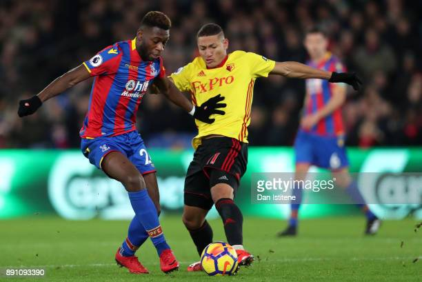 Richarlison de Andrade of Watforad and Timothy FosuMensah of Crystal Paalce in action during the Premier League match between Crystal Palace and...