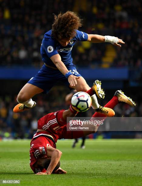 Richarlison de Andrade of Watford and David Luiz of Chelsea clash during the Premier League match between Chelsea and Watford at Stamford Bridge on...