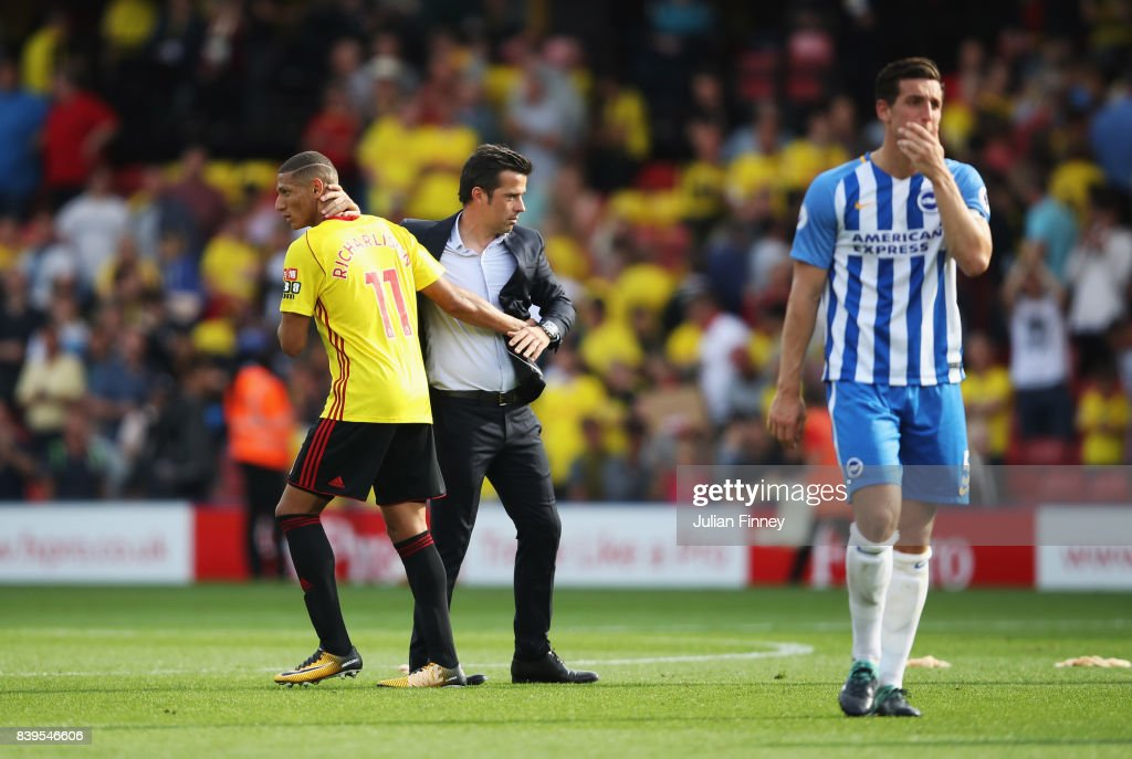 Richarlison de Andrade of Watford and Marco Silva, Manager of Watford embrace after the Premier League match between Watford and Brighton and Hove Albion at Vicarage Road on August 26, 2017 in Watford, England.