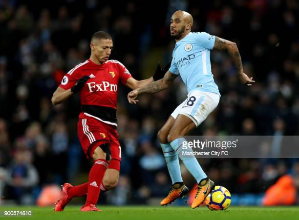 Richarlison de Andrade of Watford attempts to get past Fabian Delph of Manchester City during the Premier League match between Manchester City and...