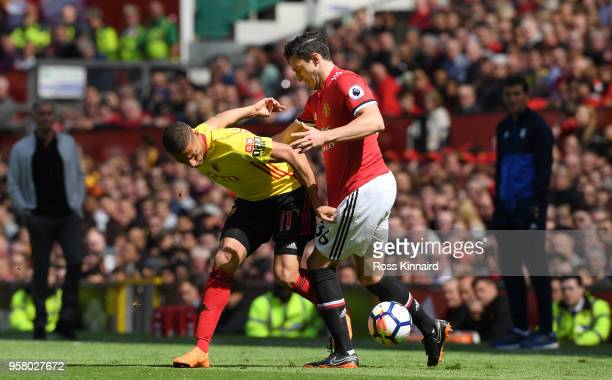 Richarlison de Andrade of Watford battles for possession with Matteo Darmian of Manchester United during the Premier League match between Manchester...