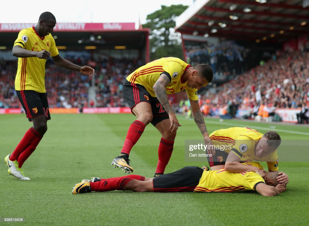 Richarlison de Andrade of Watford celebrates scoring his sides first goal with his Watford team mates during the Premier League match between AFC Bournemouth and Watford at Vitality Stadium on August 19, 2017 in Bournemouth, England.