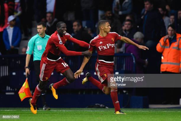 Richarlison de Andrade of Watford celebrates scoring his side's second goal with his team mate Abdoulaye Doucoure during the Premier League match...