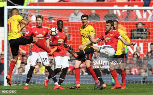 Richarlison de Andrade of Watford challanges Michael Carrick of Manchester United during the Premier League match between Manchester United and...