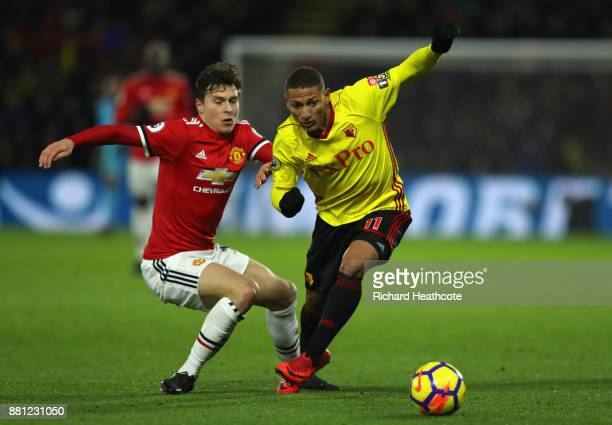 Richarlison de Andrade of Watford evades Victor Lindelof of Manchester United during the Premier League match between Watford and Manchester United...