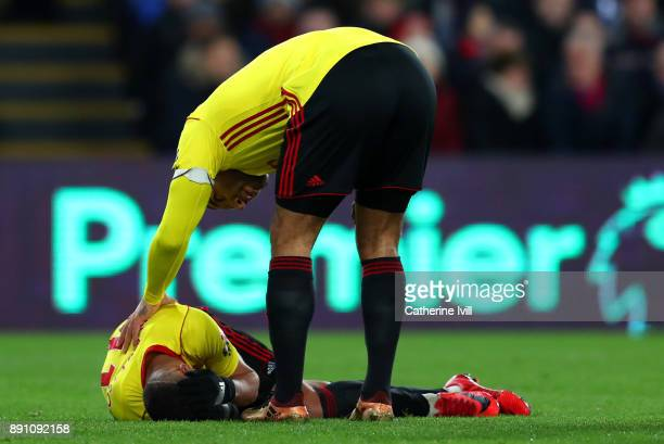 Richarlison de Andrade of Watford goes down injured whilst Troy Deeney of Watford checks on him during the Premier League match between Crystal...