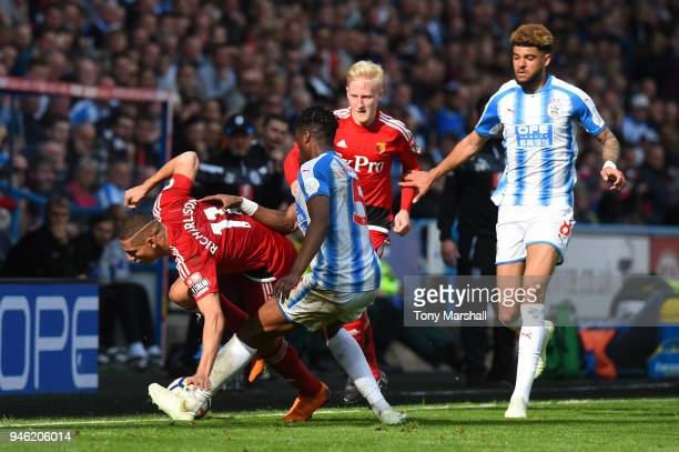 Richarlison de Andrade of Watford is challenged by Terence Kongolo of Huddersfield Town during the Premier League match between Huddersfield Town and...