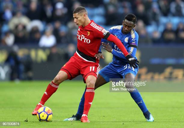 Richarlison de Andrade of Watford is challenged by Wilfred Ndidi of Leicester City during the Premier League match between Leicester City and Watford...