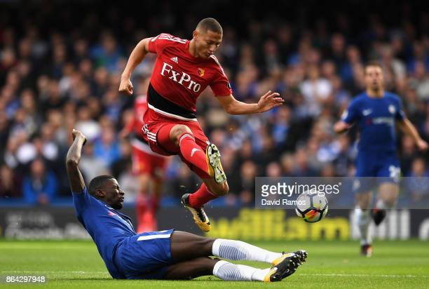 Richarlison de Andrade of Watford is tackled by Antonio Rudiger of Chelsea during the Premier League match between Chelsea and Watford at Stamford...