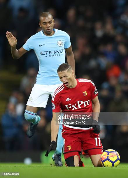 Richarlison de Andrade of Watford reacts after being fouled by Fernandinho of Manchester City during the Premier League match between Manchester City...